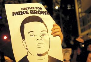 A poster in Ferguson, USA depicting Michael Brown. REUTERS/Stephen Lam