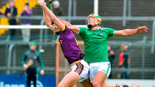 Jack O'Connor of Wexford in action against Dan Morrissey of Limerick