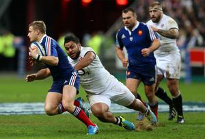 Billy Vunipola of England closes down Jules Plisson of France