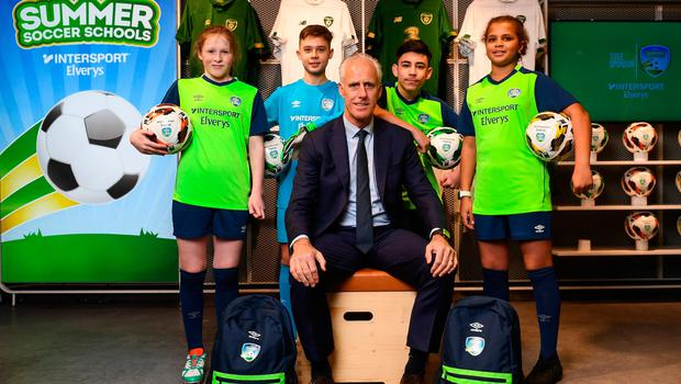 SUMMER TIME: The FAI have a new partnership with the leading Irish sports retailer INTERSPORT Elverys, as the new title sponsor of the FAI Summer Soccer Schools, pictured at the announcement is Republic of Ireland manager Mick McCarthy with Larkin Community College students, from left, Isabelle Baker, Adrain Lucaci, Remis Galiceanu and Alisha Rose Sammy. Photo: Stephen McCarthy/Sportsfile