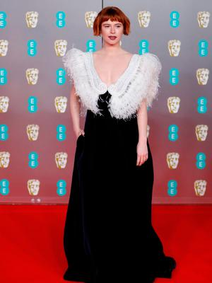 Irish actress Jessie Buckley poses on the red carpet upon arrival at the BAFTA British Academy Film Awards at the Royal Albert Hall in London on February 2, 2020. (Photo by Tolga AKMEN / AFP)