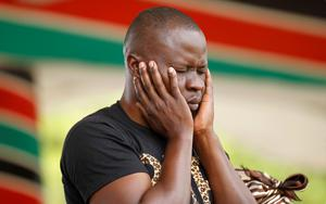 A Christian faithful from the World Victory Centre prays during an Easter crusade service for the victims of the Garissa University attack in Kenya's capital Nairobi April 5, 2015.REUTERS/Thomas Mukoya
