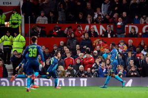 Arsenal's Danny Welbeck (right) celebrates scoring his sides second goal of the game alongside teammate Santi Cazorla during the FA Cup, Sixth Round match at Old Trafford