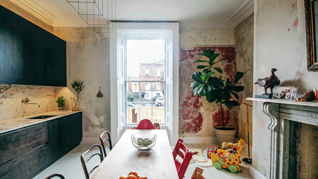 Esther Gerrard and Ed Coveney live in the duplex apartment: restored sash window