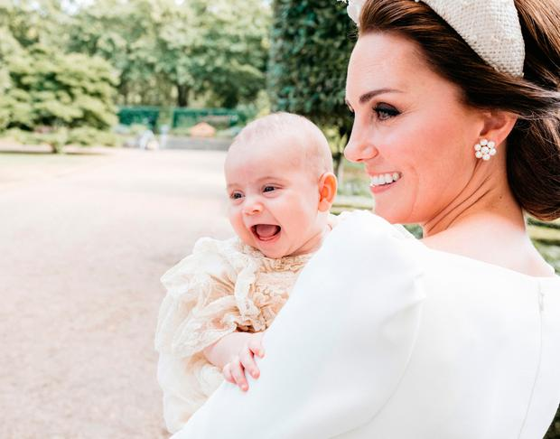 The Duke and Duchess of Cambridge have released this additional photograph taken Monday 9th July by Matt Porteous in the garden at Clarence House, following Prince Louis's baptism at the Chapel Royal, St. James's Palace. Photo: Matt Porteous/PA Wire