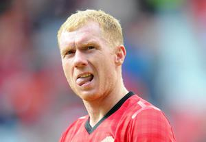 Manchester United's Paul Scholes believes 'Marcos Rojo and Phil Jones have the makings of a partnership at centre-half and Sunday will be the kind of test that defines them' (Martin Rickett/PA Wire)