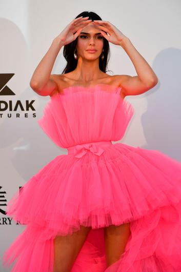US model Kendall Jenner poses as she arrives on May 23, 2019 at the amfAR 26th Annual Cinema Against AIDS gala at the Hotel du Cap-Eden-Roc in Cap d'Antibes, southern France, on the sidelines of the 72nd Cannes Film Festival. (Photo by Alberto PIZZOLI / AFP)