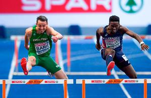 Thomas Barr leaps over the final hurdle on his way to winning bronze at the European Championships last night. Photo: Sam Barnes/Sportsfile
