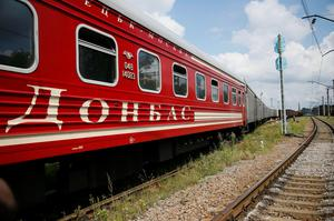 """A passenger carriage with the word """"Donbass"""", part of the train carrying the remains of victims of Malaysia Airlines MH17 downed over rebel-held territory in eastern Ukraine"""