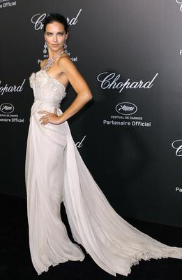 Brazilian model Adriana Lima arrives to the Chopard 'Backstage party' on the sidelines of the 67th Cannes film festival at the Cannes-Mandelieu aerodrome on May 19, 2014 in Cannes, southeastern France.   AFP PHOTO / JEAN CHRISTOPHE MAGNENET        (Photo credit should read JEAN CHRISTOPHE MAGNENET/AFP/Getty Images)