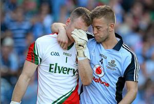Mayo goalkeeper Robert Hennelly being consoled by Dublin's Jonny Cooper at the end of the All-Ireland Final. The social value the volunteers, and players, within the GAA have created for free for decades will, to a certain extent, be commodified by the Sky Sports deal.