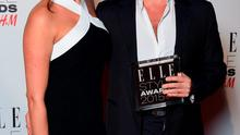 Simon Cowell with his Outstanding Contribution to Entertainment award and Lauren Silverman during the Elle Style Awards 2015