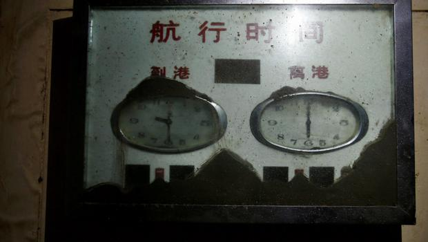 """Clocks at the passengers' hall are seen inside the Eastern Star cruise ship, which capsized on the Jianli section of the Yangtze River, Hubei province, June 7, 2015. The Chinese characters on top of the clocks read """"Voyage Schedule"""", """"Arrival"""" and """"Departure"""". Picture taken June 7, 2015. REUTERS/China Daily"""