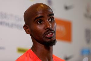 Mo Farah answers questions at a press conference before pulling out of Birmingham's Diamond League meeting