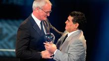 Argentinian soccer legend Diego Armando Maradona, right, awards the trophy for The Best FIFA Men's Coach award to Claudio Ranieri. Photo: AP