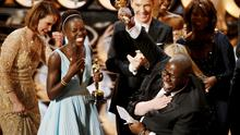 Director and producer Steve McQueen (R) celebrates after accepting the Oscar for best picture with Lupita Nyong'o (L) at the 86th Academy Awards in Hollywood, California March 2, 2014.  REUTERS/Lucy Nicholson (UNITED STATES TAGS: ENTERTAINMENT) (OSCARS-SHOW)