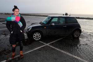 Selina Callaghan, from Kerrykeel, Donegal, at the car park on Salthill Promenade in Galway which she was parked in when storm Eleanor hit, leaving her to drive to safety through waves crashing onto the road. Photo: Brian Lawless/PA Wire