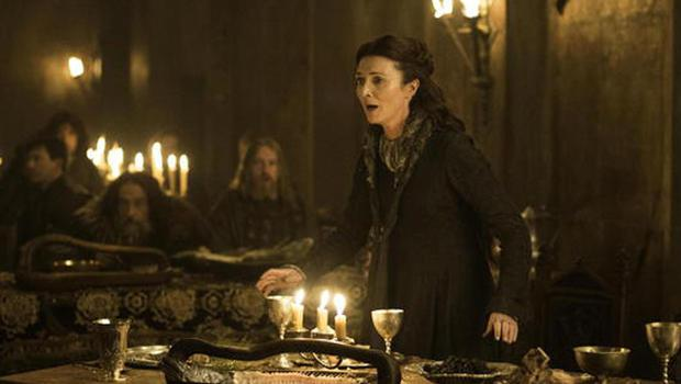 Catelyn Stark looks on in horror as members of her family are slaughtered. Photo: Game of Thrones / HBO