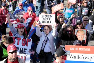 Supporters of U.S. President Donald Trump protest the election outside the TCF Center, in Detroit, Michigan