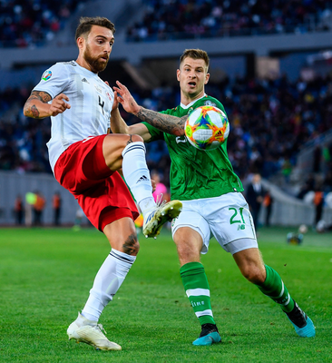 Guram Kashia of Georgia in action against James Collins of Republic of Ireland. Photo by Stephen McCarthy/Sportsfile