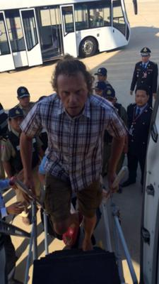 Russian real estate tycoon Sergei Polonsky boards a plane at Phnom Penh International Airport, Cambodia, May 17. Polonsky was deported from Cambodia to Russia, an official said on Sunday, where he would face embezzlement charges after evading Russian law enforcement officials for nearly two years (REUTERS/Russian Ministry of Internal Affairs)