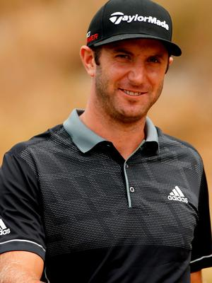 Dustin Johnson walks off the eighth hole tee during the first round at Chambers Bay