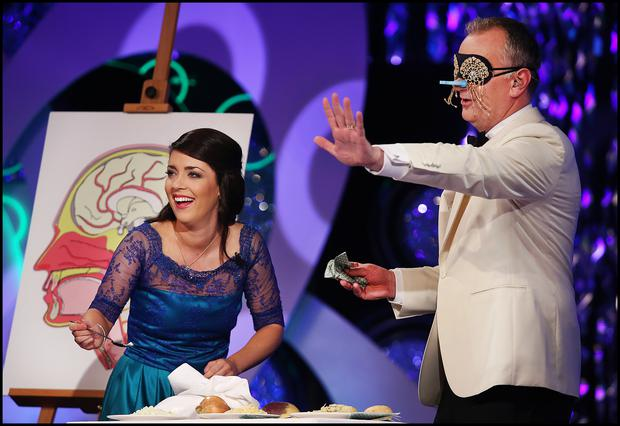 Chicago Rose Teresa Daly gives presenter Dathi O'Se the Taste Test at the Rose of Tralee International Festival in Tralee Co Kerry. Pic Steve Humphreys 21st August 2017