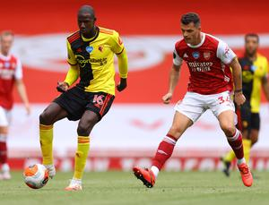 Watford's Abdoulaye Doucoure in action with Arsenal's Granit Xhaka. Photo: Reuters