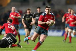 Munster's James Downey bursts through the Ospreys defence to score under the posts