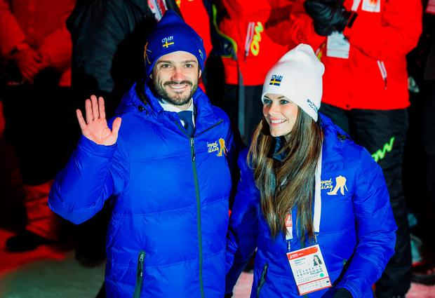 Prince Carl Philip of Sweden (L) and his fiancee Sofia Hellqvist leave the opening ceremony of the 2015 FIS Nordic World Ski Championships in Falun, Sweden