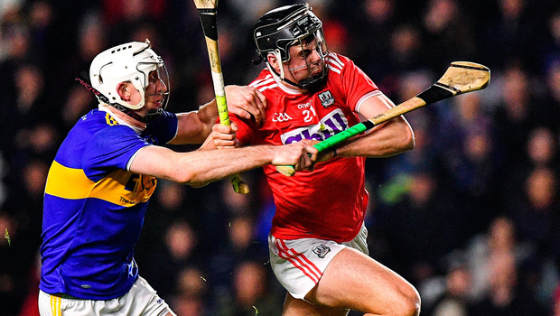 Darragh Fitzgibbon of Cork is tackled by Séamus Kennedy of Tipperary. Photo by Eóin Noonan/Sportsfile
