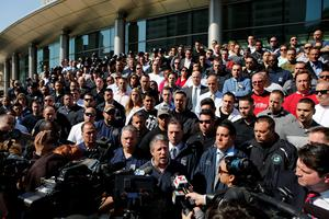 Police Benevolent Association President Pat Lynch (C ) speaks to the media supported by NYPD officers in uniform and plainclothes at the steps of the Queens criminal court in New York May 3, 2015. REUTERS/Eduardo Munoz