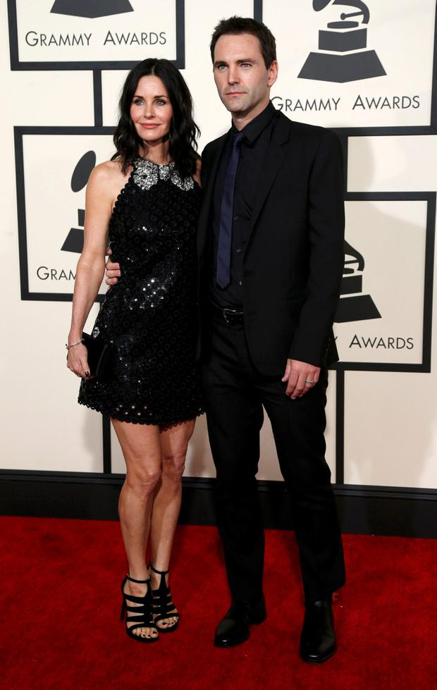 Actress Courteney Cox and songwriter Johnny McDaid arrive at the 57th annual Grammy Awards in Los Angeles, California February 8, 2015.