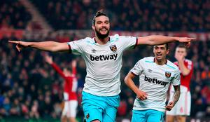 West Ham United's Andy Carroll celebrates scoring his side's second goal during the Premier League match at the Riverside Stadium