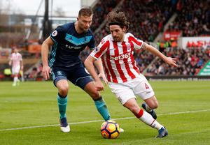 Stoke City's Joe Allen in action with Middlesbrough's Ben Gibson. Photo: Reuters