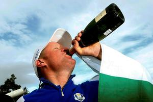Team Europe golfer Jamie Donaldson celebrates with champagne after winning his match against U.S. player Keegan Bradley to retain the Ryder Cup for Europe on the 15th green during the 40th Ryder Cup at Gleneagles in Scotland September 28, 2014.        REUTERS/Eddie Keogh (BRITAIN  - Tags: SPORT GOLF)