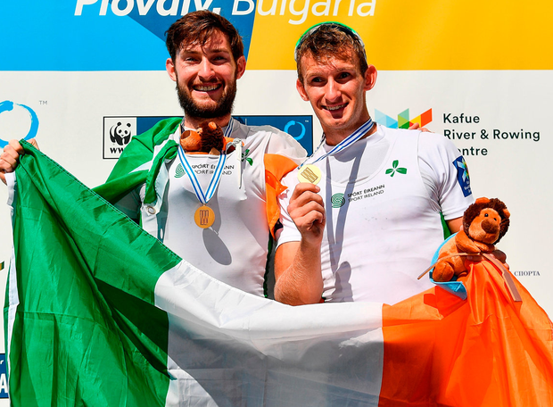 Paul O'Donovan, left, and Gary O'Donovan on the podium following their victory in the Lightweight Men's Double Sculls Final. Photo: Seb Daly/Sportsfile