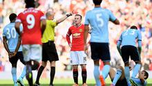 Wayne Rooney is shown a red card by referee Lee Mason. Laurence Griffiths/Getty Images
