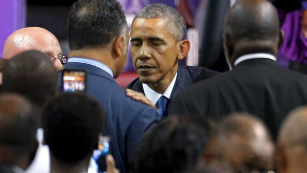 U.S. President Barack Obama  talks with Rev. Jesse Jackson (L) at the conclusion of funeral services for the Rev. Clementa Pinckney in Charleston, South Carolina June 26, 2015. Pinckney is one of nine victims of a mass shooting at the Emanuel African Methodist Episcopal Church.  REUTERS/Brian Snyder