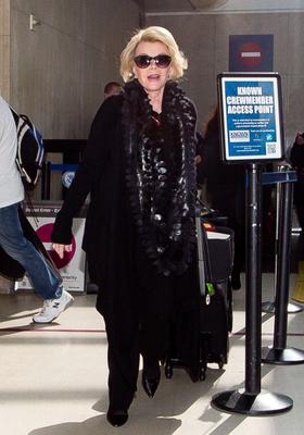 Joan Rivers is seen at LAX airport on January 25, 2014 in Los Angeles, California.  (Photo by GVK/Bauer-Griffin/GC Images)