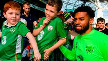 Cyrus Christie takes a picture with some young fans following a Republic of Ireland training session at the Aviva Stadium in Dublin. Photo: Stephen McCarthy/Sportsfile