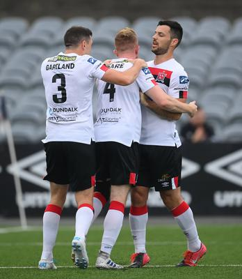 Sean Hoare is congratulated by Dundalk team-mates Brian Gartland, left, and Patrick Hoban, right, after scoring the winning goal against Waterford. Photo by Stephen McCarthy/Sportsfile