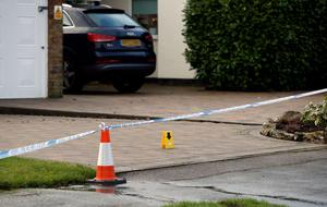 The scene in Fetcham, Surrey, as murder squad detectives launched a manhunt after the bodies of a man and a woman were found at a property in Fetcham.