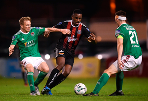 Andre Wright of Bohemians in action against Conor McCormack, left, and Conor McCarthy of Cork City