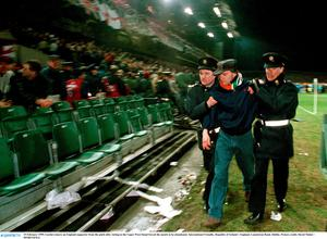 15 February 1995; Gardai remove an England supporter from the pitch after rioting in the Upper West Stand forced the match to be abandoned. International Friendly, Republic of Ireland v England, Lansdowne Road, Dublin. Picture credit; David Maher / SPORTSFILE