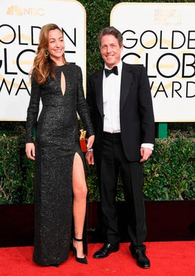 Actor Hugh Grant (R) and producer Anna Elisabet Eberstein attend the 74th Annual Golden Globe Awards at The Beverly Hilton Hotel on January 8, 2017 in Beverly Hills, California.  (Photo by Frazer Harrison/Getty Images)