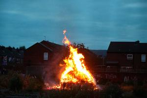 A bonfire is lit on Belfast's Shankill Road as bonfires were set to be lit at midnight, as part of a loyalist tradition to mark the anniversary of the Protestant King William's victory over the Catholic King James at the Battle of the Boyne in 1690. Photo credit: Niall Carson/PA Wire