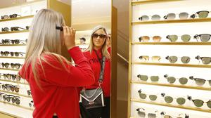 Stylish: Civa Connell from Ratoath tries on a pair of glasses as Brown Thomas on Grafton Street reopened after being closed for three months. Photo: Leon Farrell/Photocall