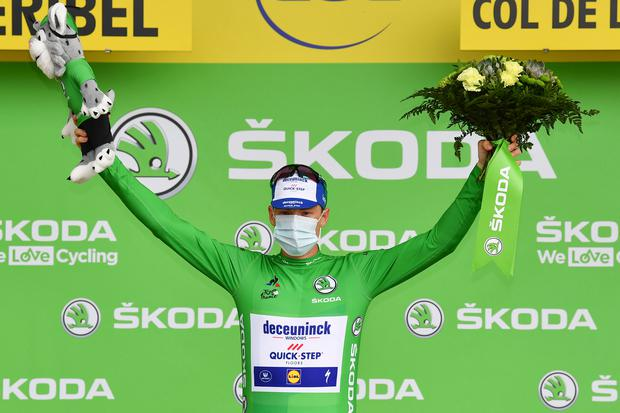 Ireland's Sam Bennett, wearing the best sprinter's green jersey, celebrates on the podium after stage 17 of the Tour de France cycling race over 107 kilometers from Grenoble to Meribel Col de la Loze. (Stuart Franklin/Pool via AP)