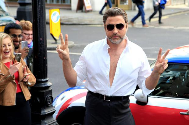 David Walliams arrives dressed as Simon Cowell for the Britain's Got Talent Launch held at Regents Street Cinema in London. PRESS ASSOCIATION Photo. Picture date: Thursday April 7, 2016. See PA story SHOWBIZ Talent. Photo credit should read: Jonathan Brady/PA Wire